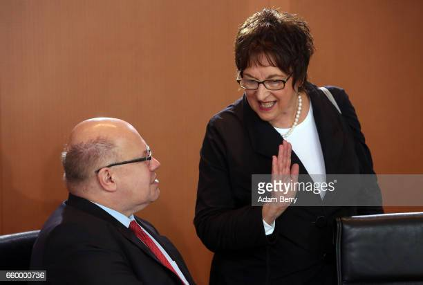 Minister of the Chancellery Peter Altmaier and Economy and Energy Minister Brigitte Zypries arrive for the weekly German federal Cabinet meeting on...
