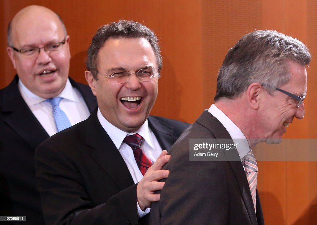 Minister of the Chancellery Peter Altmeier (CDU), Agriculture and Consumer Protection Minister <a gi-track='captionPersonalityLinkClicked' href=/galleries/search?phrase=Hans-Peter+Friedrich&family=editorial&specificpeople=7528072 ng-click='$event.stopPropagation()'>Hans-Peter Friedrich</a> (CSU), and Interior Minister <a gi-track='captionPersonalityLinkClicked' href=/galleries/search?phrase=Thomas+de+Maiziere&family=editorial&specificpeople=618845 ng-click='$event.stopPropagation()'>Thomas de Maiziere</a> (CDU) arrive for the weekly German federal Cabinet meeting on December 17, 2013 in Berlin, Germany. The meeting was the first held by the new members of Chancellor Angela Merkel's third Cabinet.