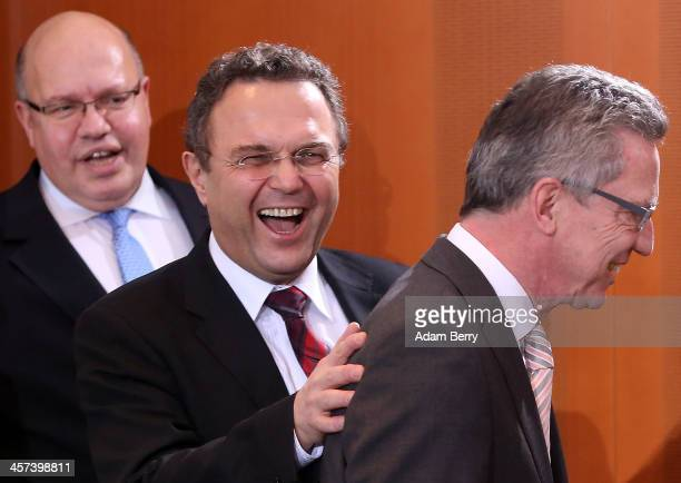 Minister of the Chancellery Peter Altmeier Agriculture and Consumer Protection Minister HansPeter Friedrich and Interior Minister Thomas de Maiziere...