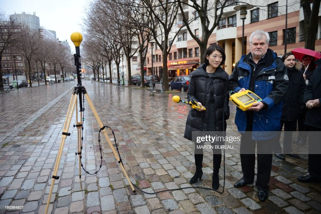 Minister of the Digital Economy, Fleur Pellerin meets with National Frequency Agency (ANF) technicians, and performs radio frequency emission measurements, electromagnetic fields tests near a mobile telephone base station antenna, on January 30, 2013 in Paris.
