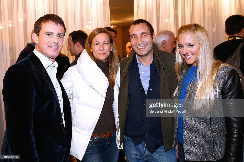Minister of the Interior <a gi-track='captionPersonalityLinkClicked' href=/galleries/search?phrase=Manuel+Valls&family=editorial&specificpeople=2178864 ng-click='$event.stopPropagation()'>Manuel Valls</a> with his wife violinist Anne Gravoin and actor <a gi-track='captionPersonalityLinkClicked' href=/galleries/search?phrase=Zinedine+Soualem&family=editorial&specificpeople=628313 ng-click='$event.stopPropagation()'>Zinedine Soualem</a> and guest attend day five of BNP Paribas Tennis Masters held at Bercy on November 1, 2013 in Paris, France.