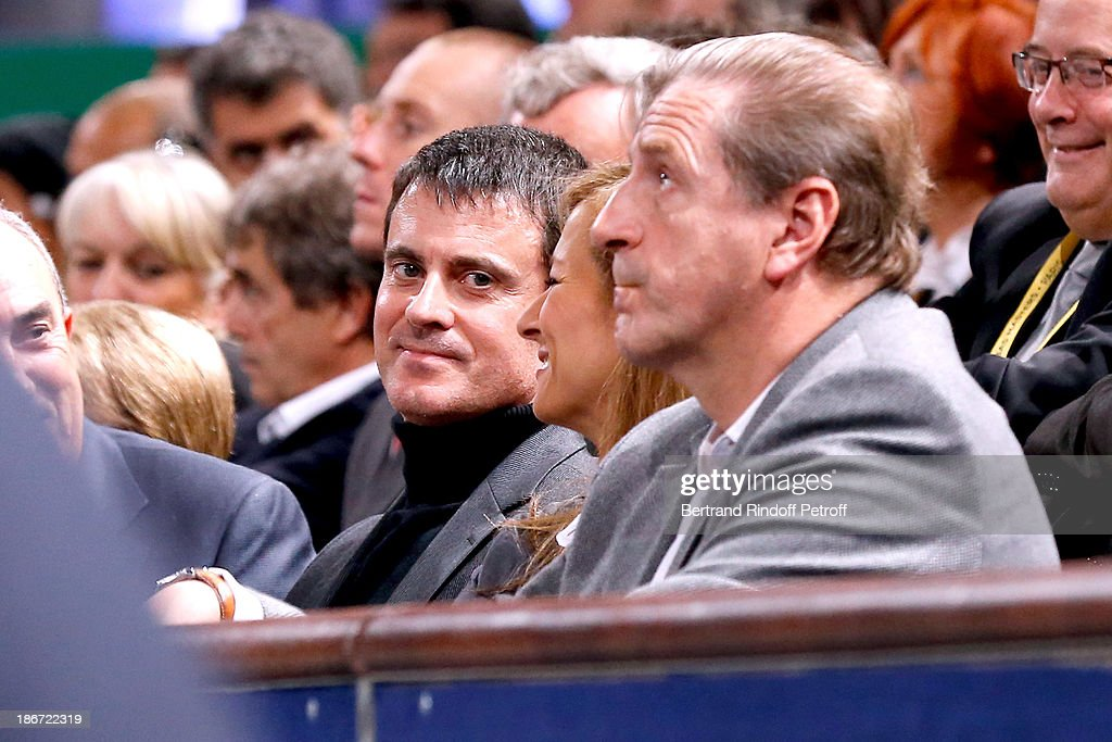 Minister of the Interior <a gi-track='captionPersonalityLinkClicked' href=/galleries/search?phrase=Manuel+Valls&family=editorial&specificpeople=2178864 ng-click='$event.stopPropagation()'>Manuel Valls</a> (C) with his wife violinist Anne Gravoin attend the final of the BNP Paribas Tennis Masters - day seven, at Palais Omnisports de Bercy on November 3, 2013 in Paris, France.
