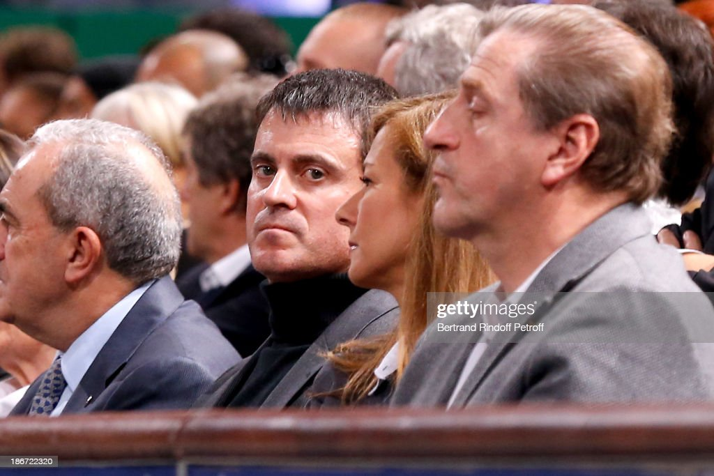 Minister of the Interior Manuel Valls (C) with his wife violinist Anne Gravoin attend the final of the BNP Paribas Tennis Masters - day seven, at Palais Omnisports de Bercy on November 3, 2013 in Paris, France.