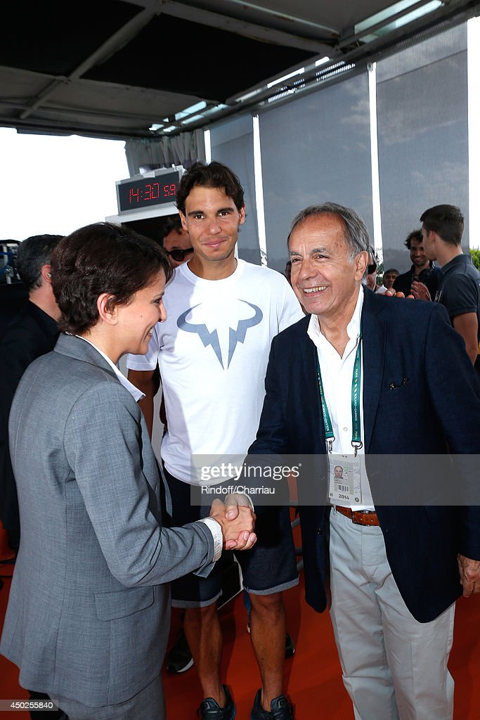 Minister of Women's Rights, the City and the Youth and Sports Najat Vallaud-Belkacem, tennis player Rafael Nadal and former tennis player Patrice Dominguez pose at France Television french chanels studio after she won the Roland Garros French Tennis Open 2014 - Day 14 on June 7, 2014 in Paris, France.