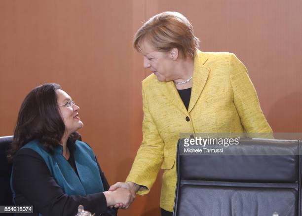 Minister of Work and Social Issues Andrea Nahles German Chancellor Angela Merkel arrive for the weekly government cabinet meeting in the german...