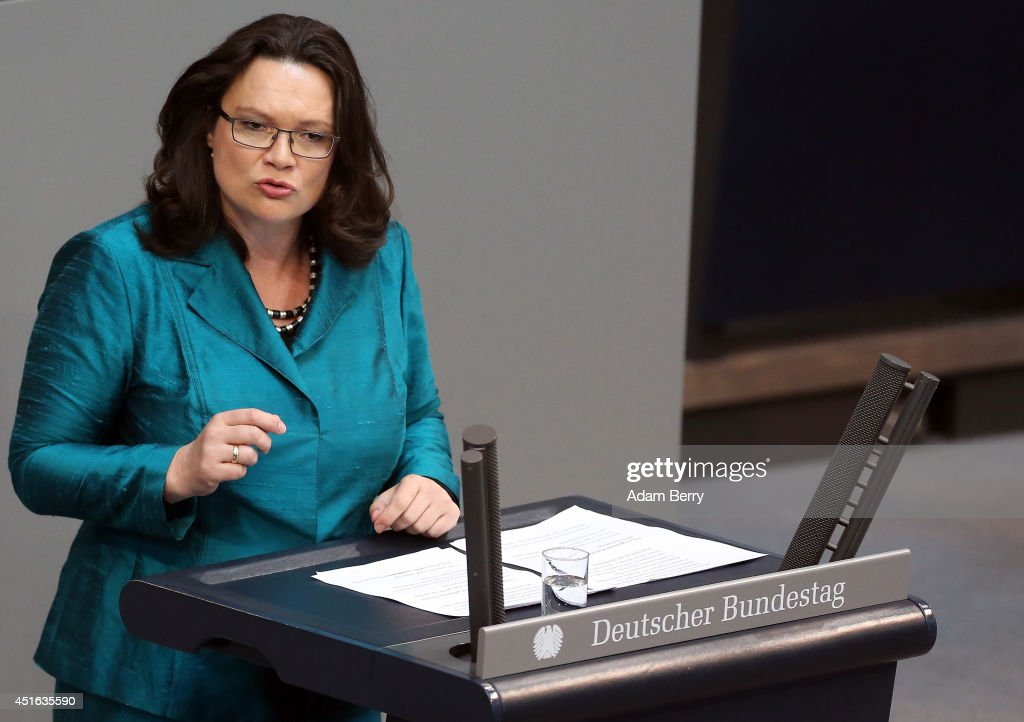 Minister of Work and Social Issues <a gi-track='captionPersonalityLinkClicked' href=/galleries/search?phrase=Andrea+Nahles&family=editorial&specificpeople=822618 ng-click='$event.stopPropagation()'>Andrea Nahles</a> (SPD) speaks during a meeting of the Bundestag, Germany's federal parliament, about a vote on exceptions to the minimum wage law to take effect from next year on July 3, 2014 in Berlin, Germany. The country voted for a minimum wage of 8.50 euros (USD 11.60) an hour, to come into effect in 2015, with exceptions for vocational trainees, minors and certain interns, to be reviewed again two years after the new law takes effect.