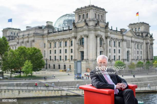 Minister President of Bavaria and leader of Bavarian CDU's sister Party CSU Horst Seehofer sits in a red chair on the terrace of the Marie Elisabeth...