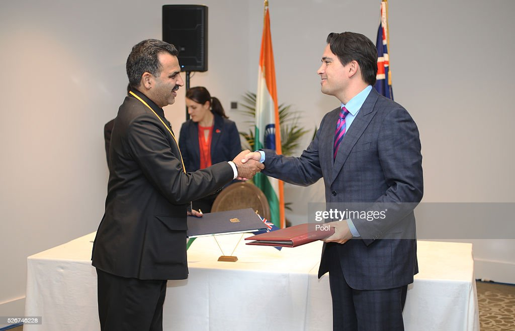 Minister Sanjeev Balyan, Indian Minister of State for Agriculture and Farmer Welfare and New Zealand Transport Minister, Simon Bridges during the the signing of the New Zealand-India Air Services Agreement at The Langham Hotel Auckland on May 1, 2016 in Auckland, New Zealand. Mukharjee is on a three-day visit to New Zealand.