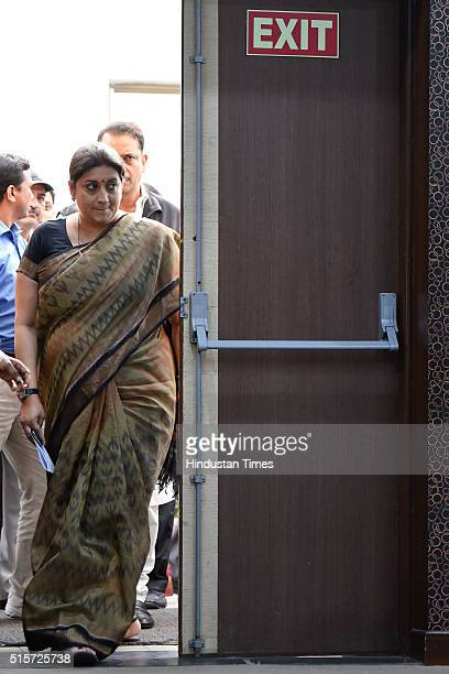 Minister Smriti Irani and BJP senior leader Rajiv Pratap Rudy arrive for the press conference at BJP Headquarters on March 15 2016 in New Delhi India...