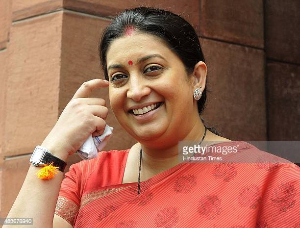 Minister Smriti Irani at Parliament House during the monsoon session on August 11 2015 in New Delhi India The lower house saw noisy scenes till its...