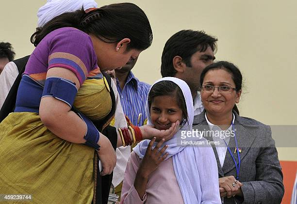 Minister Smriti Irani interacting with Wasima a Class VI student and the Brand Ambassador of Bal Swachhta Abhiyan for Haryana state at the concluding...