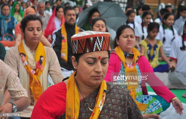 Minister Smriti Irani participates in an event on the occasion of the first International Day of Yoga at session at Chaura Maidan on June 21 2015 in...