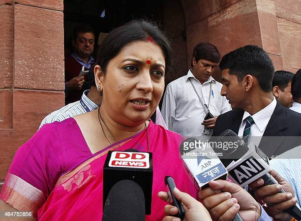 Minister Smriti Irani talks with media during the Budget session at the Parliament House on February 28 2015 in New Delhi India Union Finance...