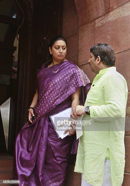 Minister Smriti Irani with Manoj Tiwari at Parliament House on August 5 2015 in New Delhi India Congress and some opposition parties on Wednesday...