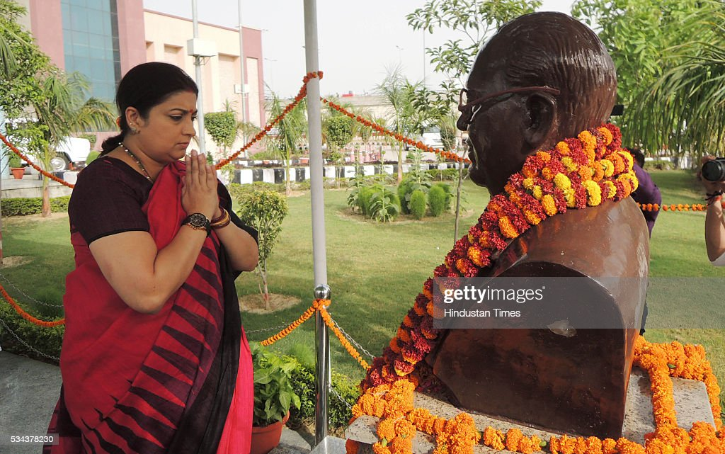 HRD minister Smriti zubin Irani showering flowers on the statue of Bhimrao Ambedkar before the launch of Bharatvani web portal (multilingual knowledge portal www.bharatvani.in) and App here at Dr. Bhimrao Ambedkar University, on May 25, 2016 in Lucknow, India. She said that under the Prime Minister Modis Digital India Mission, Bharatavani App will perform the task of bringing about digital revolution in the county. The portal has been launched in 22 languages which will be extended to 100 within a year.