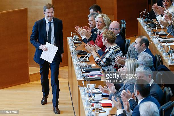 MinisterPresident of Belgium's Frenchspeaking Walloon Region Paul Magnette leaves the stage after delivering a speech as members of Parliament...