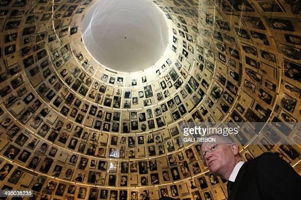 MinisterPresident of Lower Saxony and President of the German Bundesrat Stephan Weil looks at pictures of Jewish Holocaust victims at the Hall of...