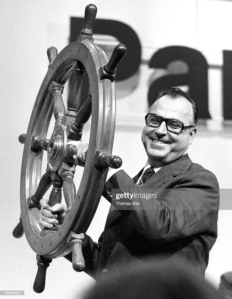 Minister-President of Rhineland-Palatinate and Chairman of the Christian Democratic Union Helmut Kohl carrying a wooden steering wheel, March 06, 1975, Mainz, Germany.
