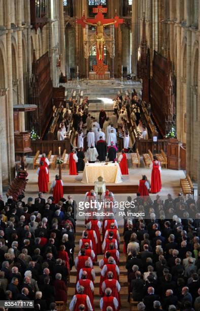 Ministers file past the coffin of The Bishop of Peterborough The Right Reverend Ian Cundy during his funeral service at Peterborough Cathedral...