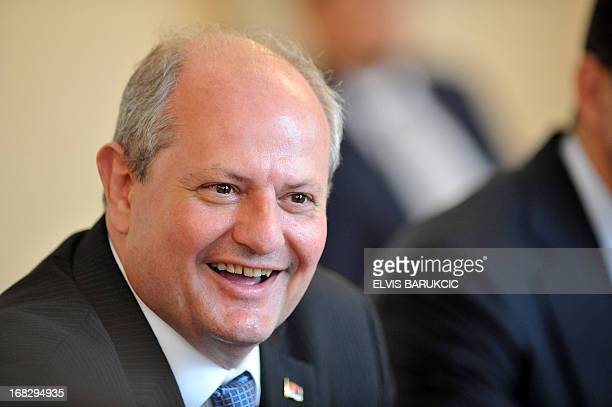 Ministers of foreign Affairs of Serbia Ivan Mrkic smiles during a meeting with members of tripartite Presidency of Bosnia and Herzegovina and Turkish...