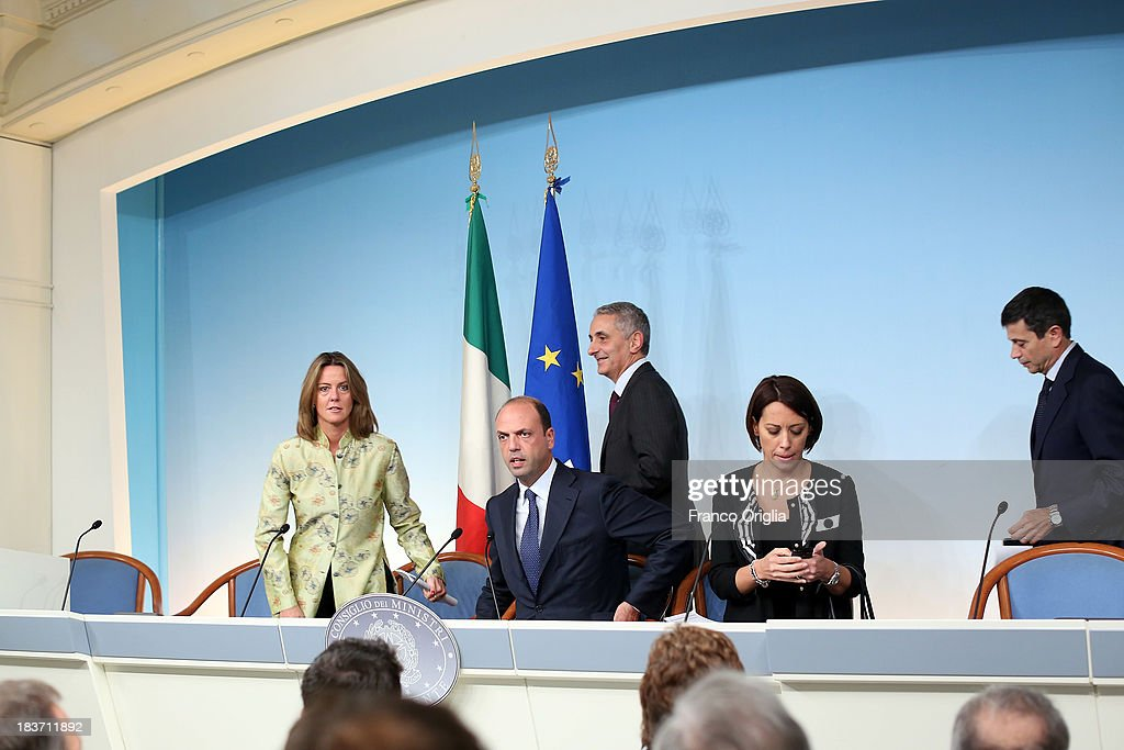 ROME, ITALY - OCTOBER 09 Ministers of the PDL (centre-right party led by Silvio Berlusconi) (L-R) Beatrice Lorenzin, Angelino Alfano, Gaetano Quagliariello, Nunzia de Girolamo and Maurizio Lupi attend a press conference at Palazzo Chigi on October 9, 2013 in Rome, Italy. After asking all his ministers to resign, Silvio Berlusconi changed his mind and voted in support of the government as Prime Minister Enrico Letta gained the confidence vote at the Italian Senate on October 2nd.