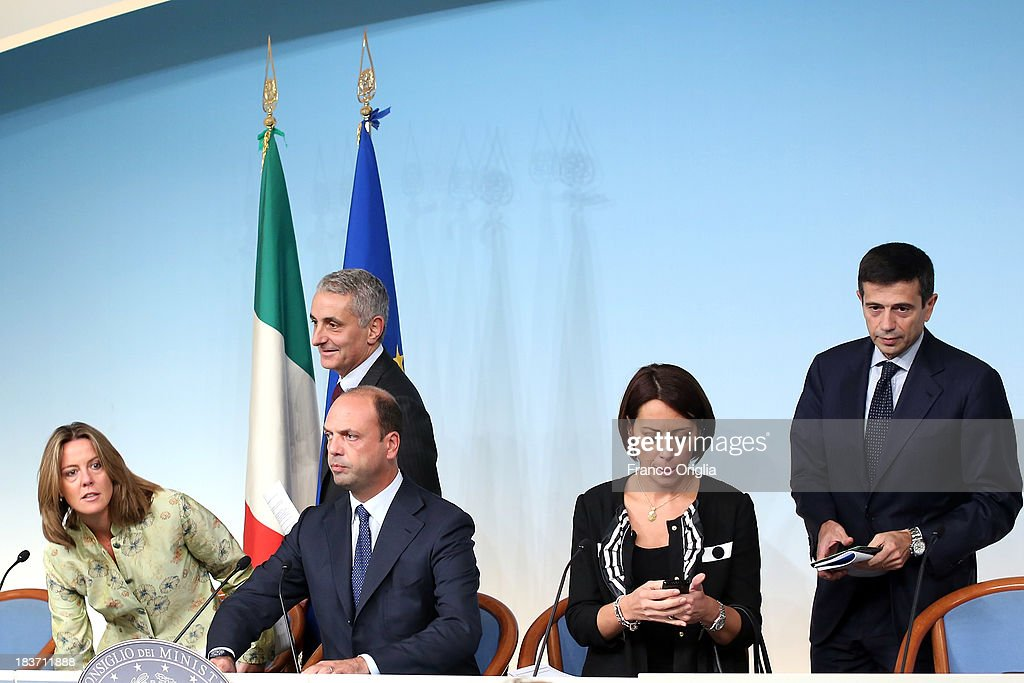 ROME, ITALY - OCTOBER 09 Ministers of the PDL (centre-right party led by Silvio Berlusconi) (L-R) Beatrice Lorenzin, Gaetano Quagliariello, Angelino Alfano, Nunzia de Girolamo and Maurizio Lupi attend a press conference at Palazzo Chigi on October 9, 2013 in Rome, Italy. After asking all his ministers to resign, Silvio Berlusconi changed his mind and voted in support of the government as Prime Minister Enrico Letta gained the confidence vote at the Italian Senate on October 2nd.