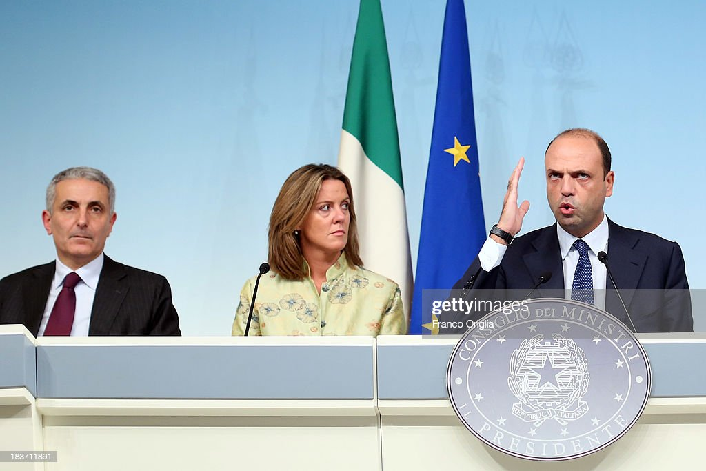 ROME, ITALY - OCTOBER 09 Ministers of the PDL (centre-right party led by Silvio Berlusconi) (L-R) Gaetano Quagliariello, Beatrice Lorenzin and Angelino Alfano attend a press conference at Palazzo Chigi on October 9, 2013 in Rome, Italy. After asking all his ministers to resign, Silvio Berlusconi changed his mind and voted in support of the government as Prime Minister Enrico Letta gained the confidence vote at the Italian Senate on October 2nd.