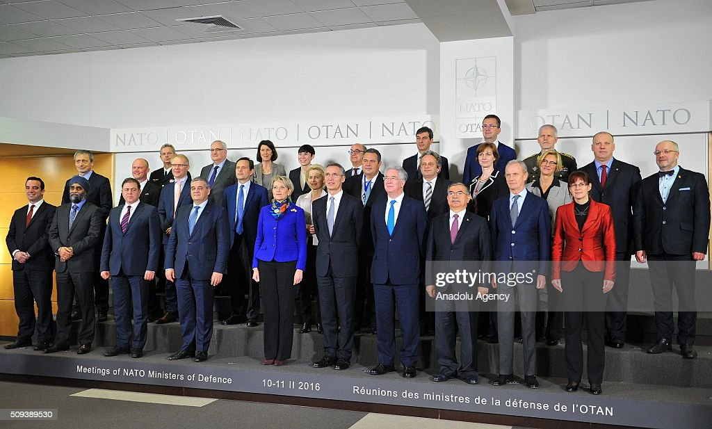 Ministers pose for a group photo during the NATO Defense Ministers meeting at the NATO headquarters in Brussels, Belgium on February 10, 2016.