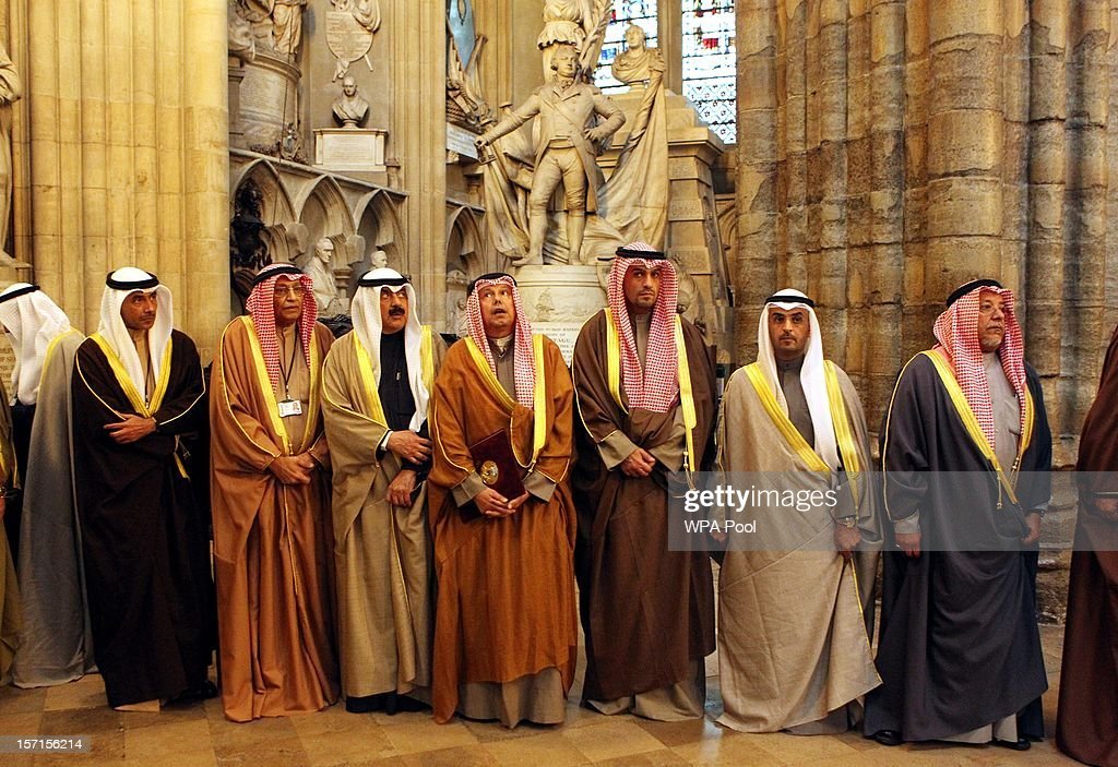 Ministers to the Amir of the State of Kuwait look on as the Amir visits Westminster Abbey to lay a wreath at the grave of the Unknown Warrior on November 29, 2012 in Windsor, England. The Amir has been on a three day State visit to the United Kingdom.