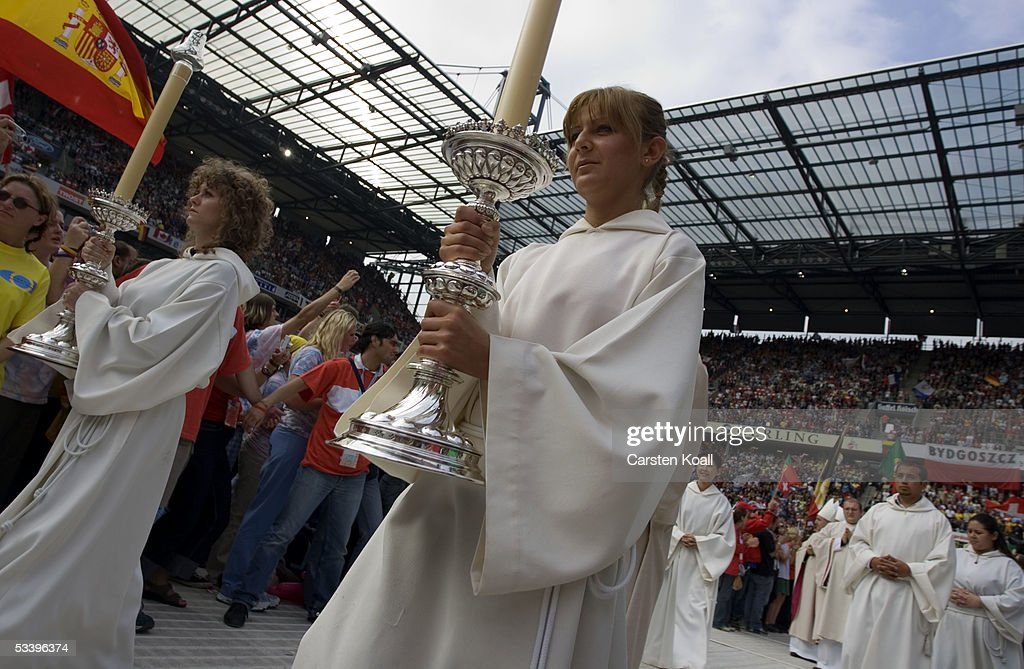 Ministrants arrive to the World Youth Day opening mass at the RheinEnergie Stadium August 16, 2005 in Cologne, Germany. Thousands of young Catholics are arriving in Germany on the first day of the World Youth Day with Pope Benedict XVI, culminating in an open-air mass on August 21 which is expected to attract 800,000 worshippers from 193 countries.