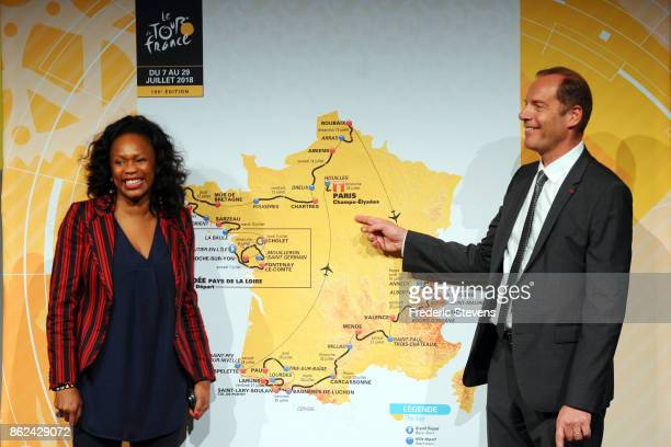 Ministrery of Sport Laura Flessel and Christian Prudhomme the director of Tour de France pose in front of the 2018 race route map during Le Tour de...