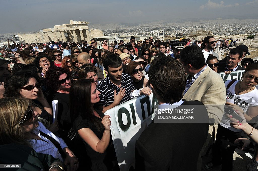 Ministry of Culture employees protest at the Acropolis archaeological site on May 25, 2010. Greek state employees hijacked a restoration event at the Acropolis in Athens on Tuesday as the government tries to force through unpopular wage cuts and hiring freezes to cut massive debt. Around 200 culture ministry staff staged a protest at the Acropolis, Greece's best-known ancient monument, to demand permanent jobs after being hired on short-term contracts for years. AFP PHOTO / Louisa Gouliamaki