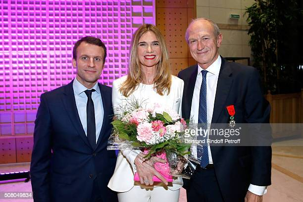 Ministry of Economy Industry and Digital Emmanuel Macron gives to President of l'Oreal JeanPaul Agon here with his companion Sophie Agon Insignia of...
