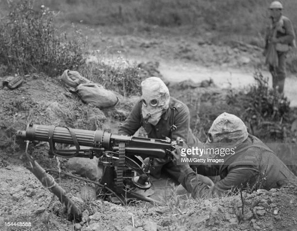 Ministry Of Information First World War Official Collection A Vickers machine gun team from the Machine Gun Corps wearing PH Type antigas helmets in...