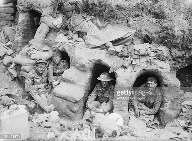 Ministry Of Information First World War Official Collection Men of the Border Regiment resting in shallow dugouts near Thiepval Wood during the...