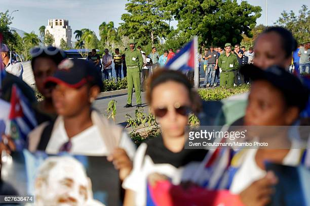 Ministry of Interior troops and Cuban youth block the access to the cemetery where Fidel Castros remains are laid to rest on December 4 in Santiago...