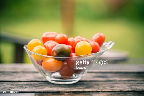 Minitomatoes in glass bowl : Stock Photo