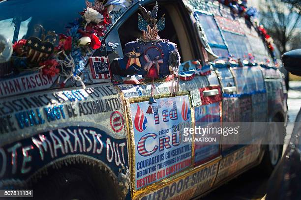A minivan covered in Republican Presidential Candidate Ted Cruz slogans is parked outside his headquarters in West Des Moines Iowa January 31 ahead...