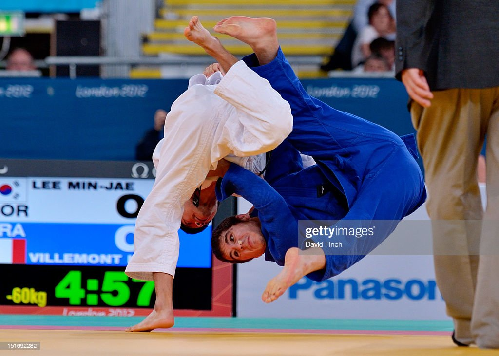 Min-Jae Lee of Korea (white) defeated Kevin Villemont of France by 2 wazari (7 points), here scoring the first, in the u60kgs repercharge during the Day 1 eliminations at the London Paralympics in the ExCeL, on August 30, 2012 in England.