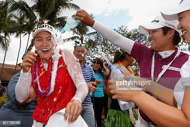 Minjee Lee of Australia has water dumped on her by Haru Nomura of Japan and Sei Young Kim of South Korea after Minjee won the LPGA LOTTE Championship...