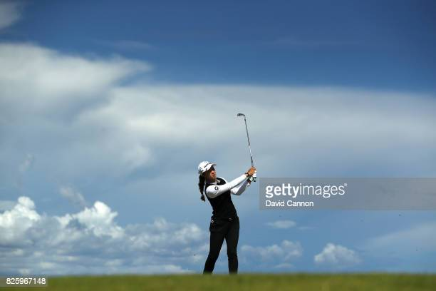 Minjee Lee of Australia hits her second shot on the 4th hole during the first round of the Ricoh Women's British Open at Kingsbarns Golf Links on...
