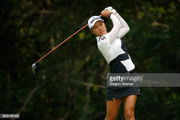 Minjee Lee of Australia hits her tee shot on the 13th hole during the first round of the 2017 KPMG PGA Championship at Olympia Fields Country Club on...