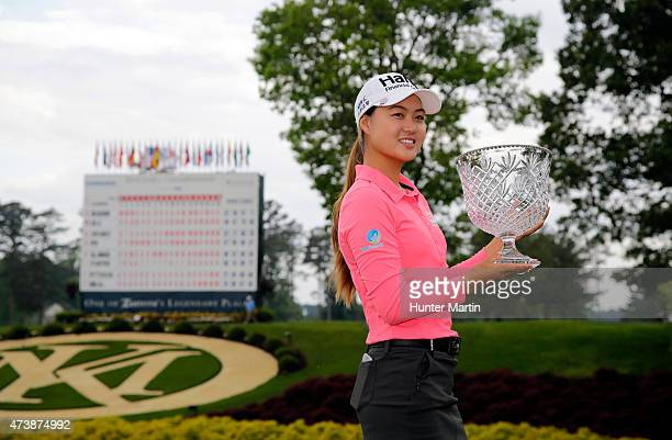 Minjee Lee of Australia holds the championship trophy after winning the Kingsmill Championship presented by JTBC on the River Course at Kingsmill...