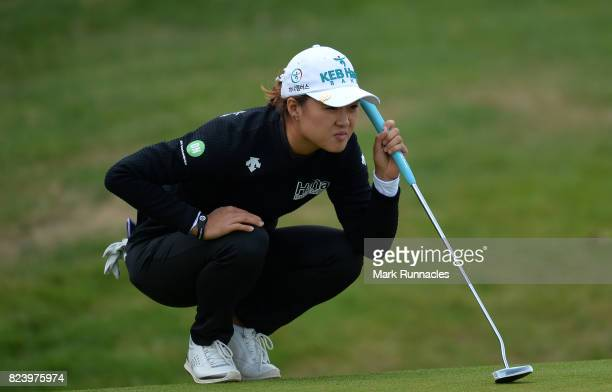 Minjee Lee of Australia lines up a putt at the 18th green during the second day of the Aberdeen Asset Management Ladies Scottish Open at Dundonald...