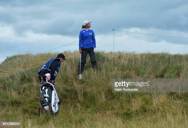 Minjee Lee of Australia plays her second shot to the 17th hole from an awkward stance during the third day of the Aberdeen Asset Management Ladies...