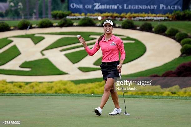 Minjee Lee of Australia waves to the crowd after putting out on the 18th hole during the continuation of final round of the Kingsmill Championship...