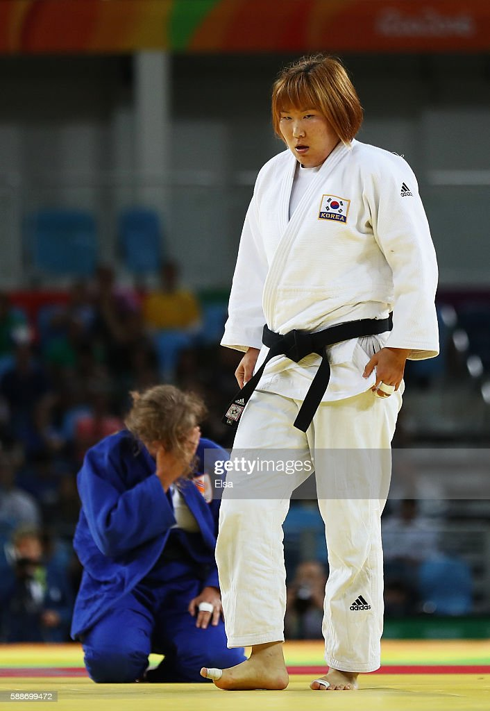 Minjeong Kim of Korea celebrates after defeating Tessie Savelkouls of the Netherlands during the Women's 78kg Judo contest on Day 7 of the Rio 2016...