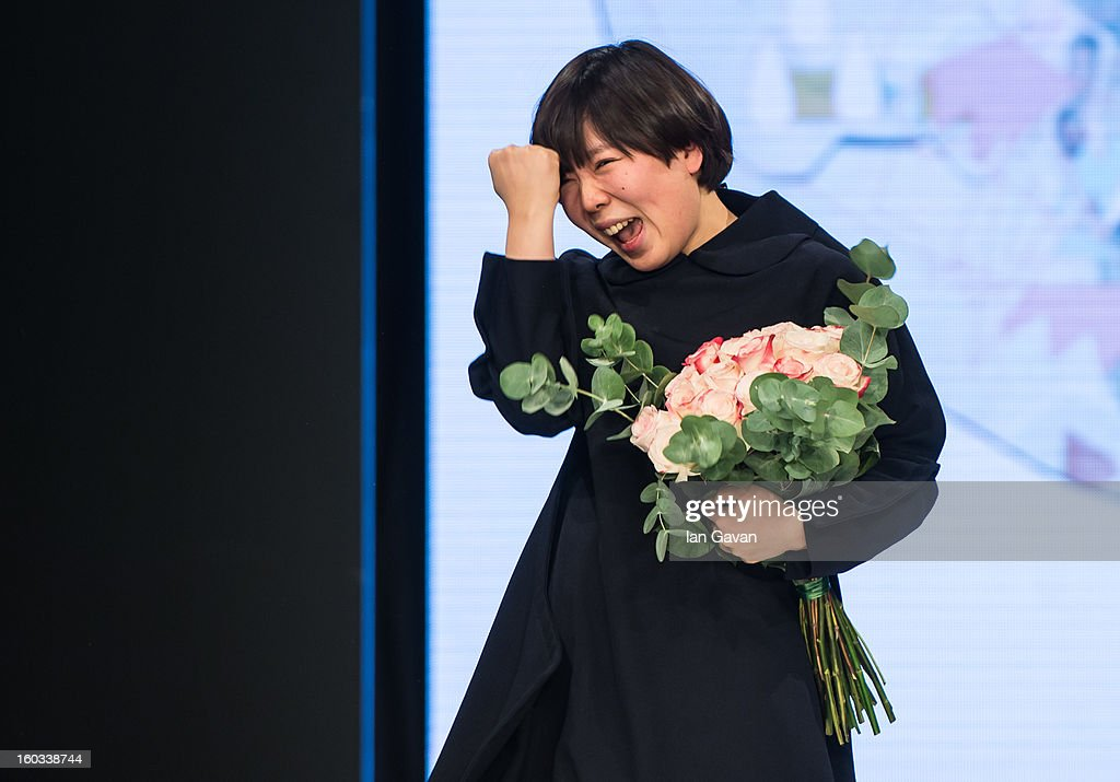Minju Kim celebrates winning the H&M Design Award at Mercedes-Benz Stockholm Fashion Week Autumn/Winter 2013 at Mercedes-Benz Fashion Pavilion on January 29, 2013 in Stockholm, Sweden.