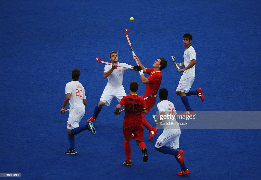 Mink van der Weerden of Belgium challenges Tom Boon of Belgium for the ball on Day 5 of the London 2012 Olympic Games at Riverbank Arena on August 1, 2012 in London, England.