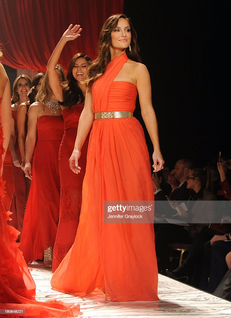 Minka Kelly and Roselyn Sanchez on the runway during The Heart Truth 2013 Fashion Show held at the Hammerstein Ballroom on February 6, 2013 in New York City.